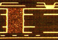 Microsection of a circuit board buried via.